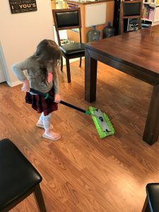 child completing her morning high five chores